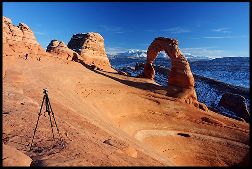 My tripod and the Delicate Arch, sunset by rickz, on Flickr